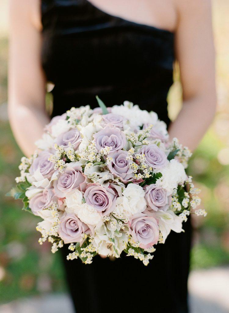bridesmaid holding lavender bridal bouquet