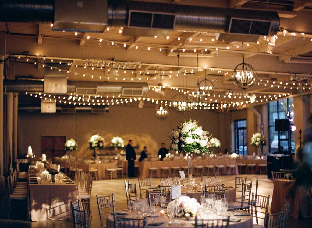 wedding reception in renovated textile mill with string lights