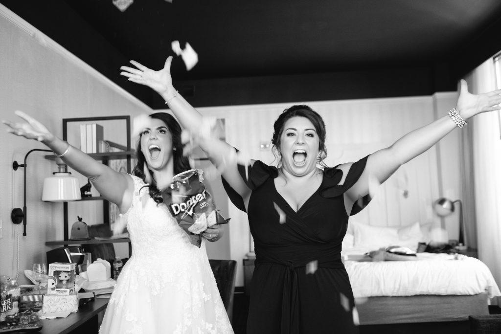 bride and bridesmaid get ready