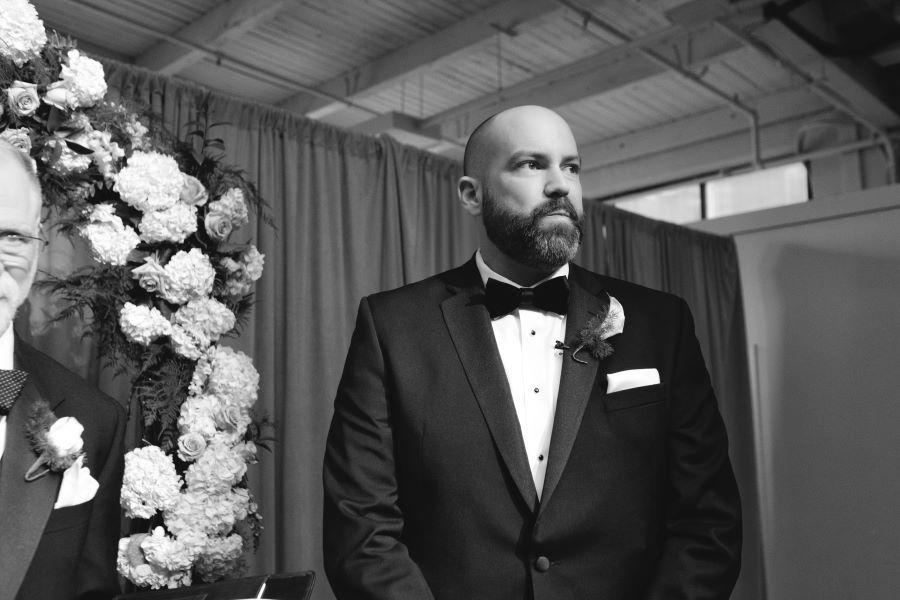 groom waits for his bride on wedding day