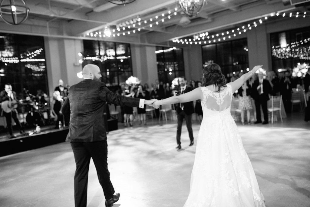 bride and groom dance on dance floor