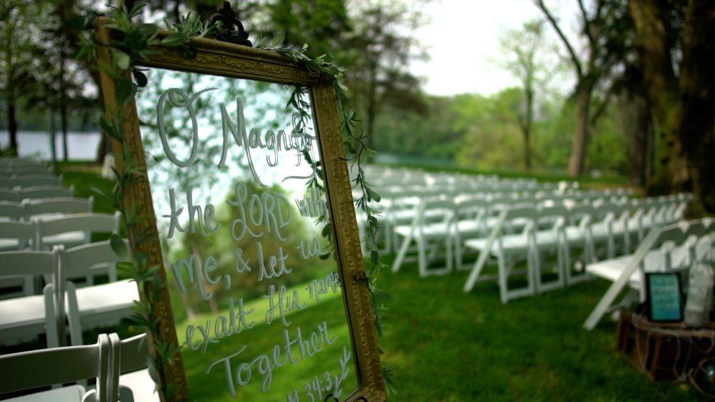 wedding details with mirrored sign