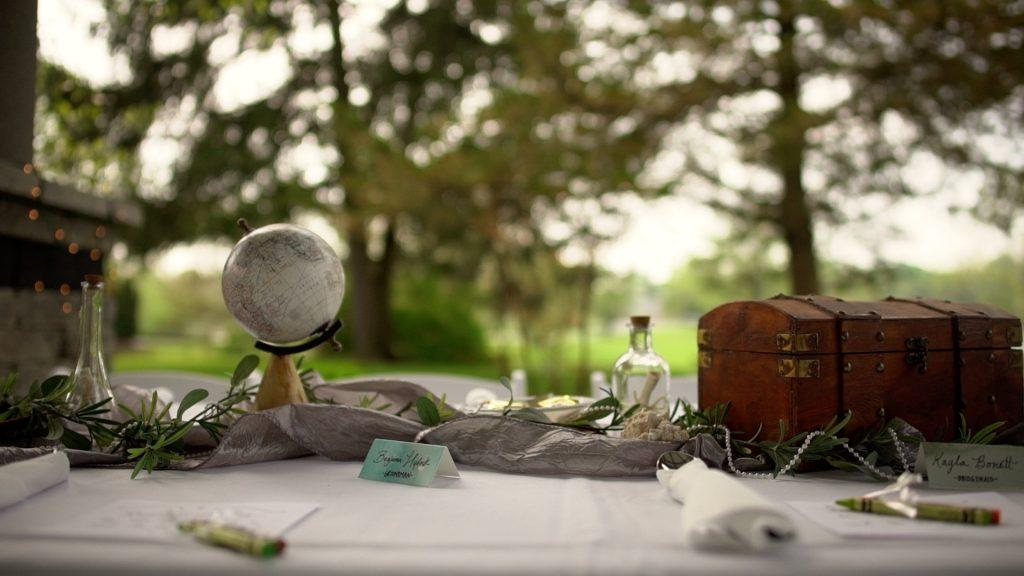 wedding table decor with mini globe and trunk