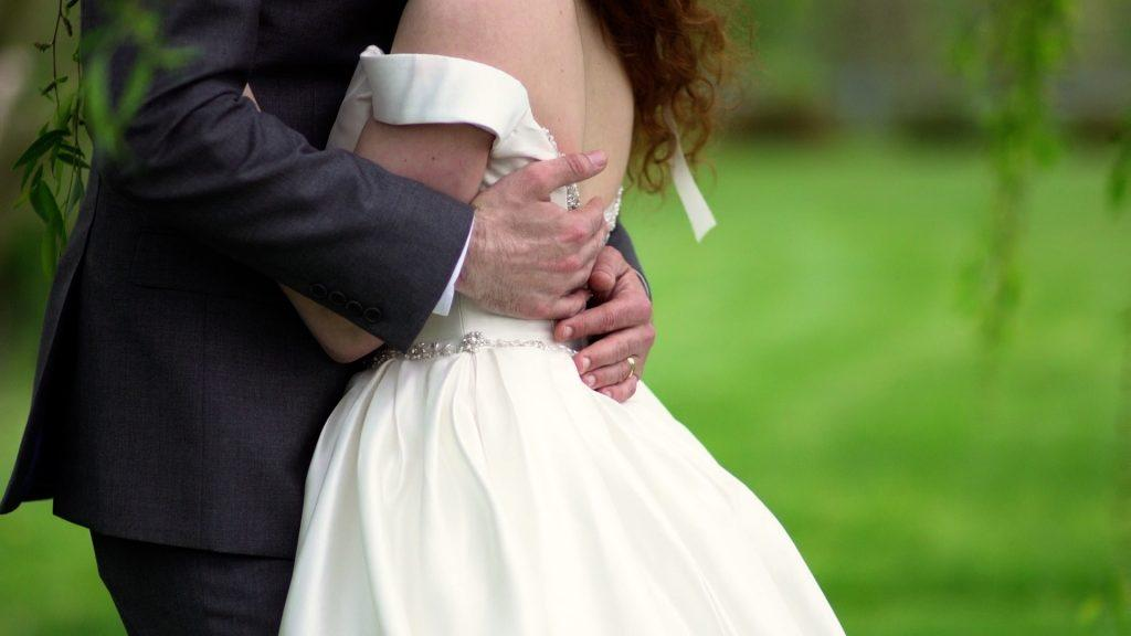 bride and groom tightly embrace