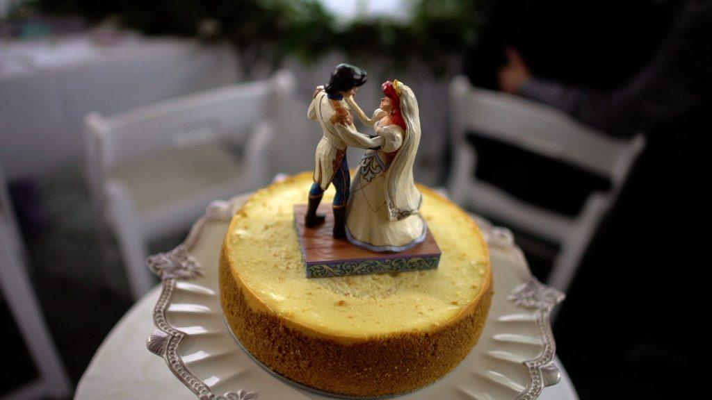 wedding cheesecake with The Little Mermaid topper
