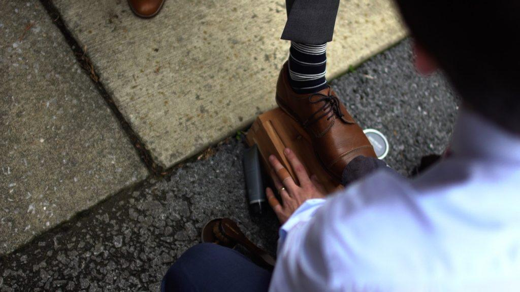 groom gets shoes shined