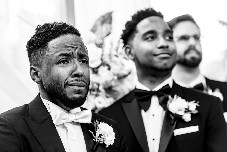 groom cries seeing his bride