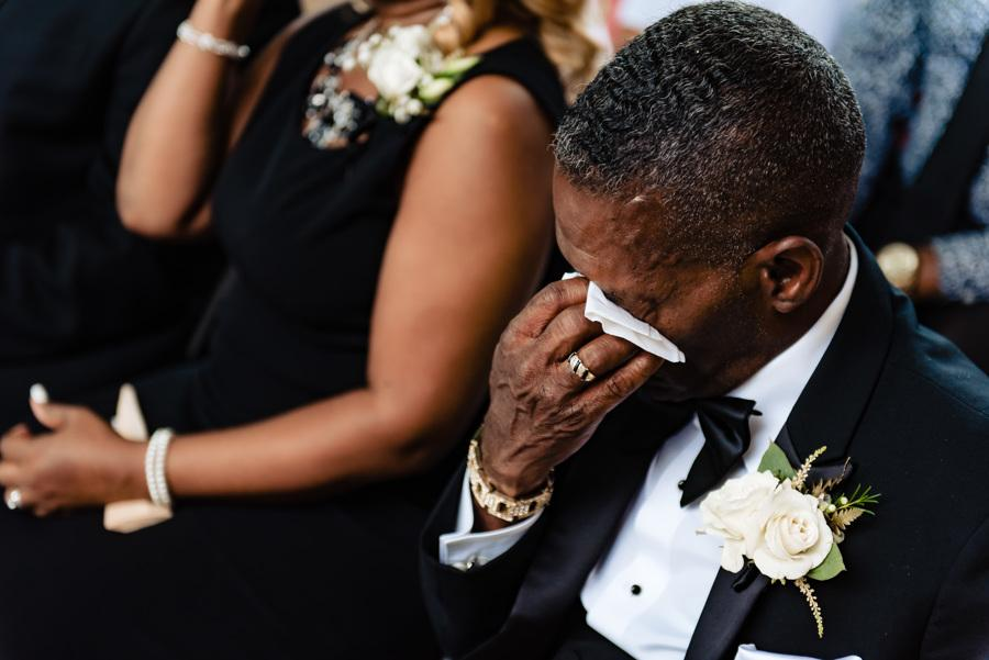 father of the bride sheds tears at wedding