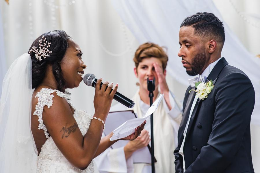bride recites vows to groom during wedding ceremony