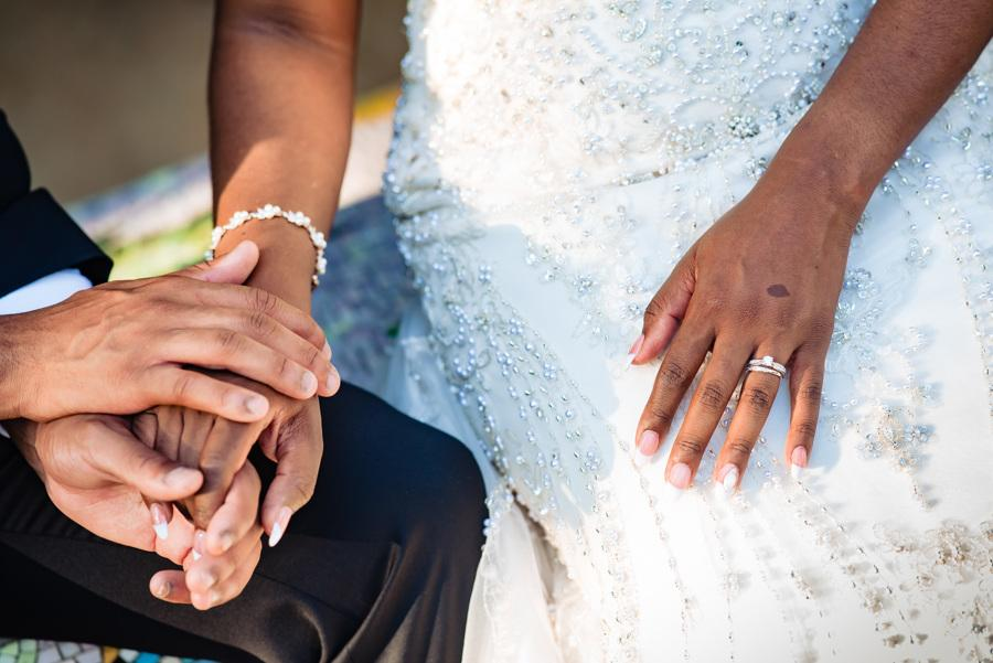groom and bride's hands with engagement ring