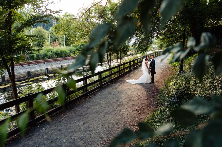 bride and groom hold hands outdoors in nature