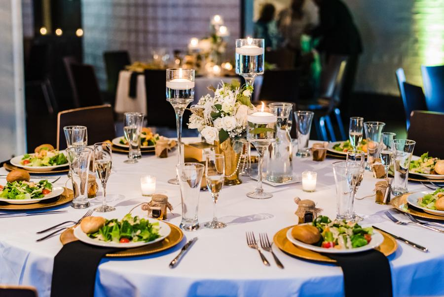 black and gold wedding table at reception