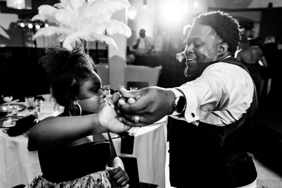 groomsman and young lady dance at wedding