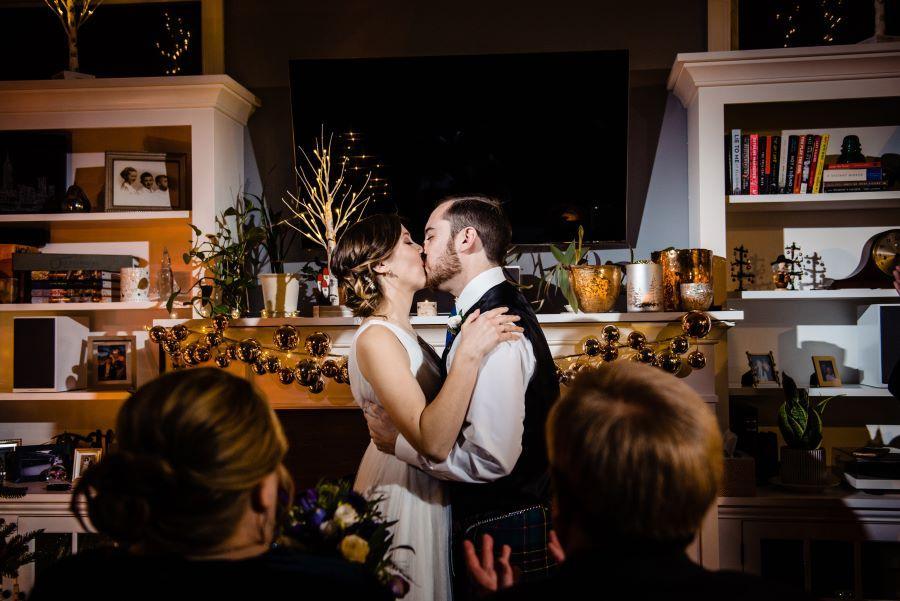 couple kiss at home wedding
