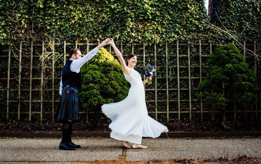groom twirls bride outside
