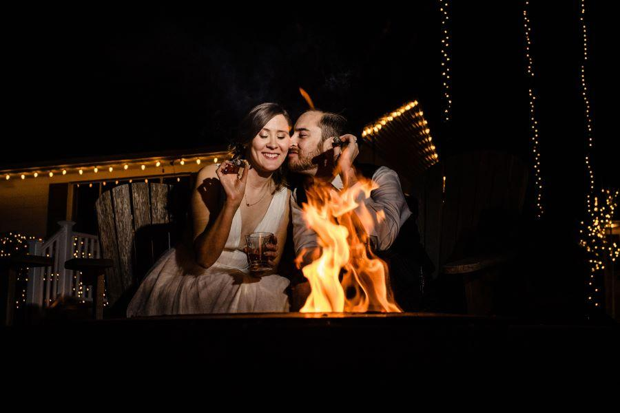 bride and groom by fire