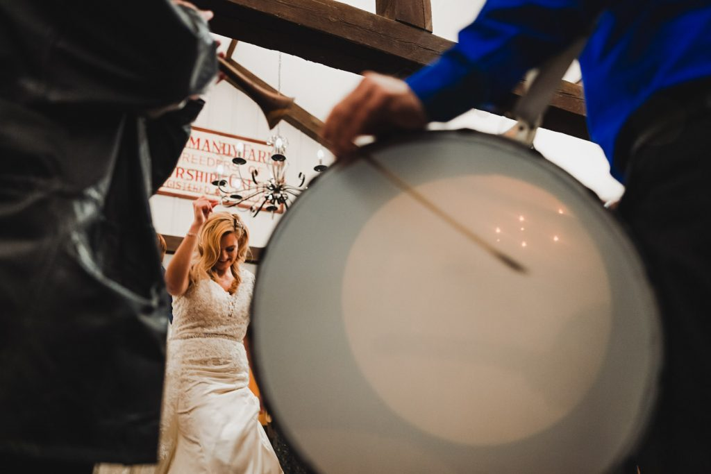 bride dances with drummer