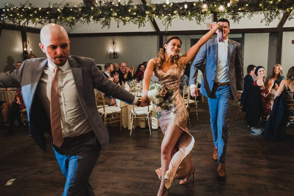 bridal party enters reception