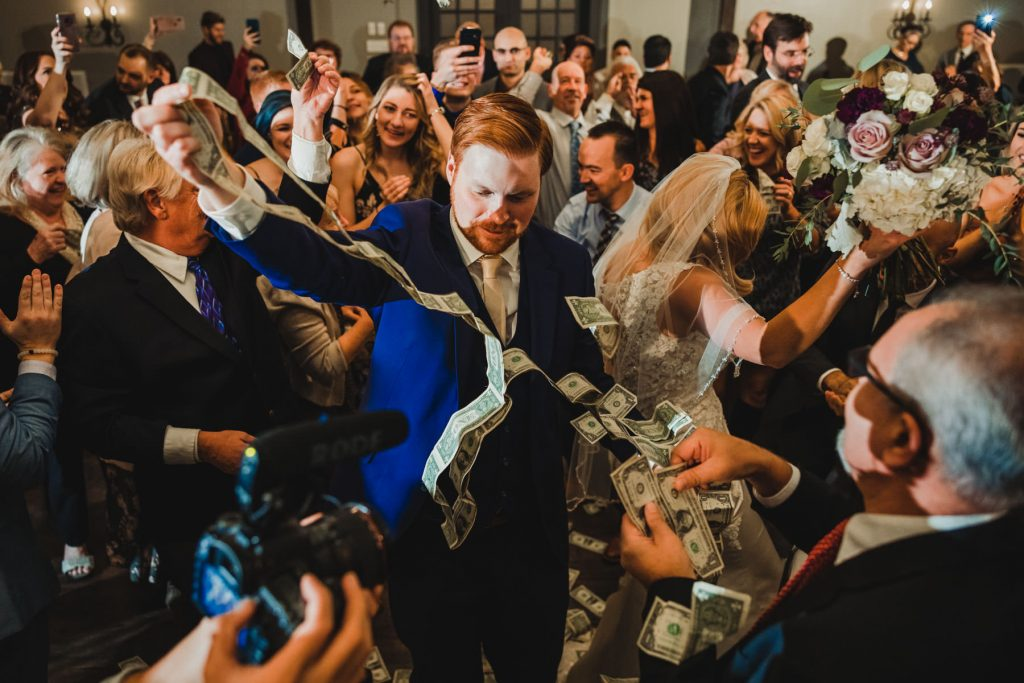 groom, bride and flying money