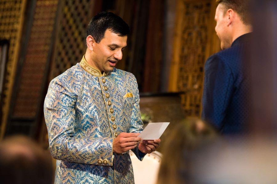 groom reads wedding vows