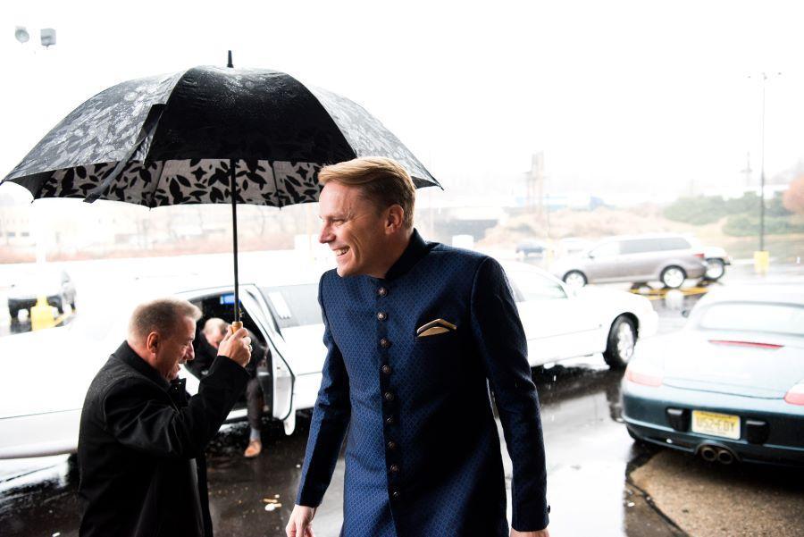 groom on rainy wedding day
