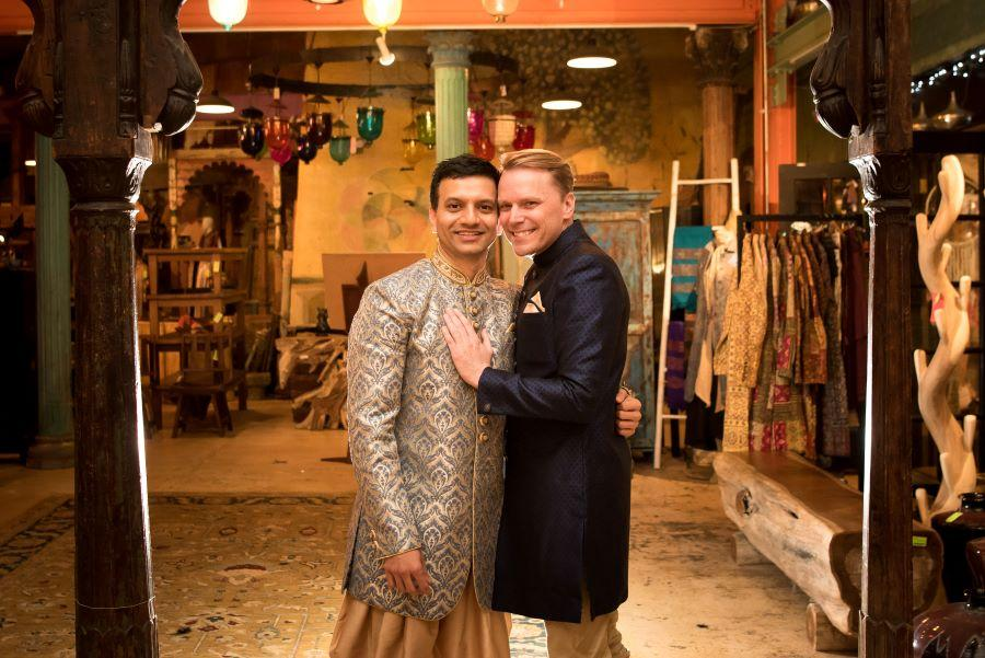 same sex couple at museum store wedding