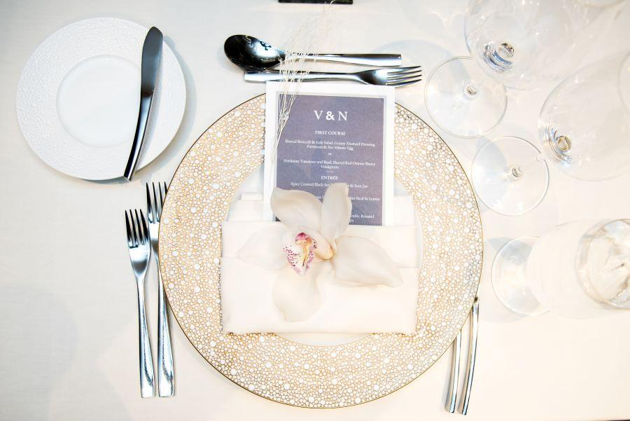 white orchid wedding table setting
