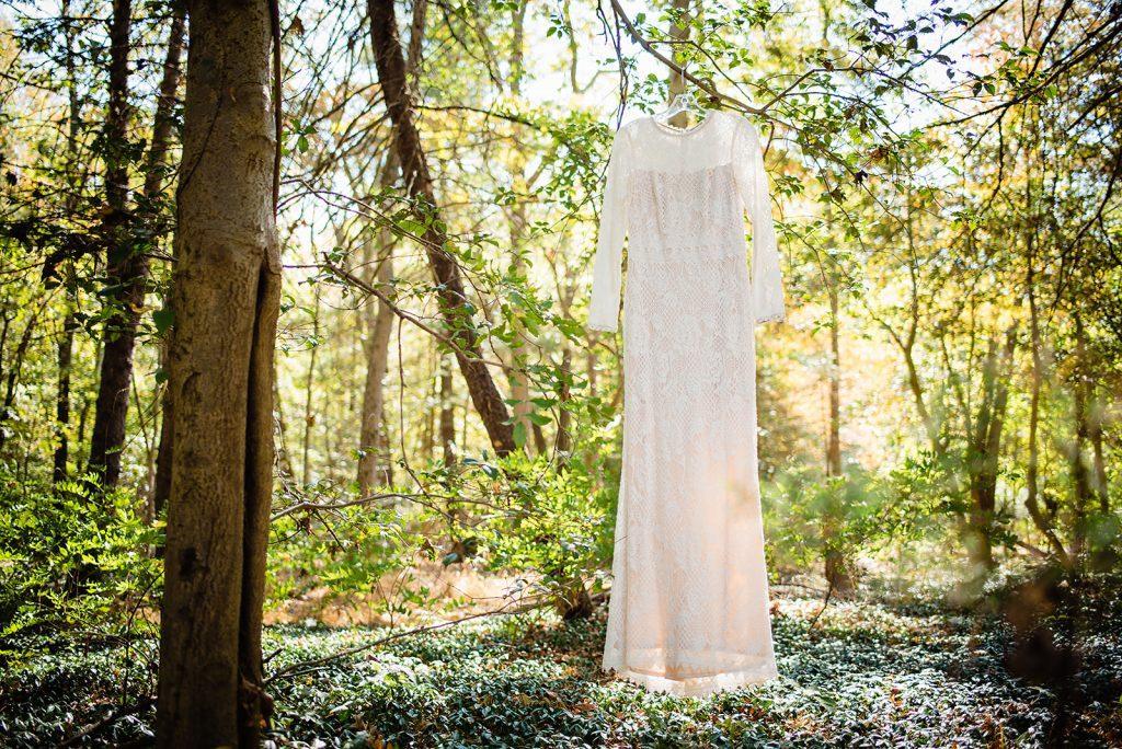 lace crochet wedding dress hanging in tree
