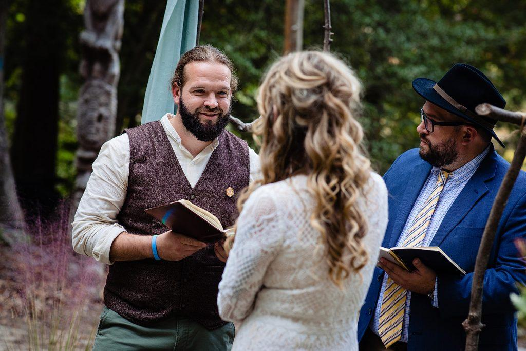 groom reads wedding vows to bride