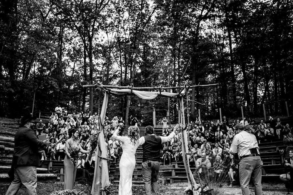 outdoor wedding ceremony under arbor