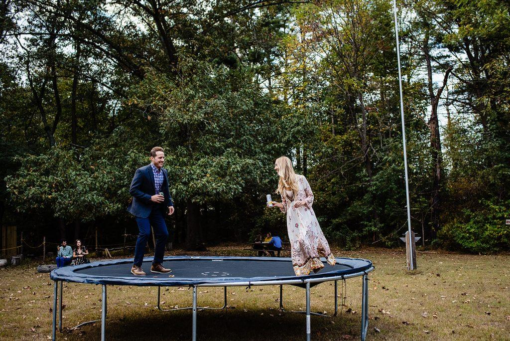 wedding guests have fun on trampoline