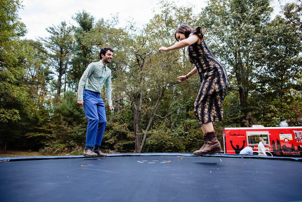 wedding guests jump on trampoline