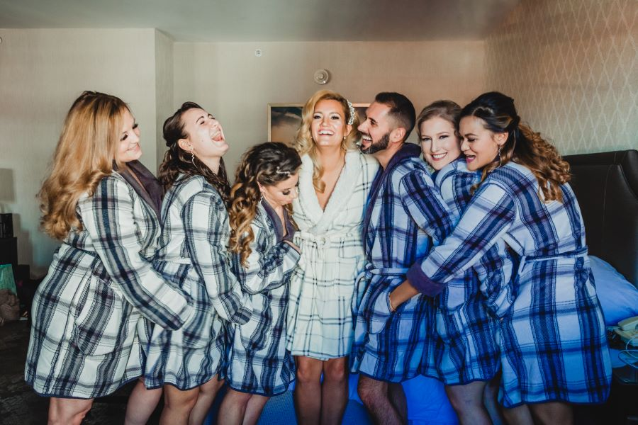 bride and bridal party in plaid robes