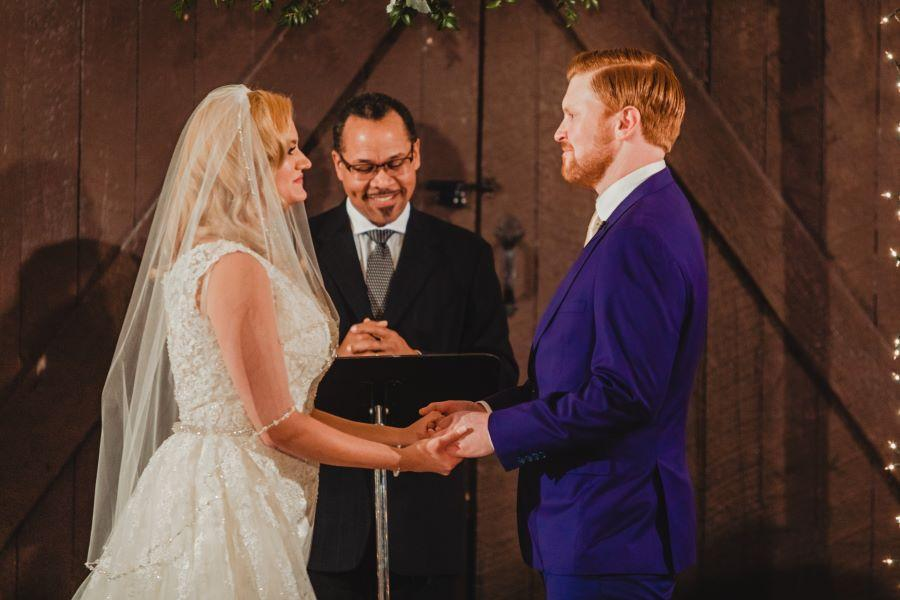 bride, groom and wedding officiant