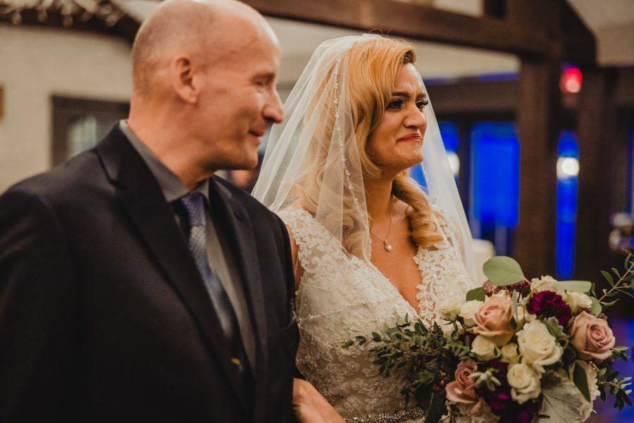 bride and father walk down aisle