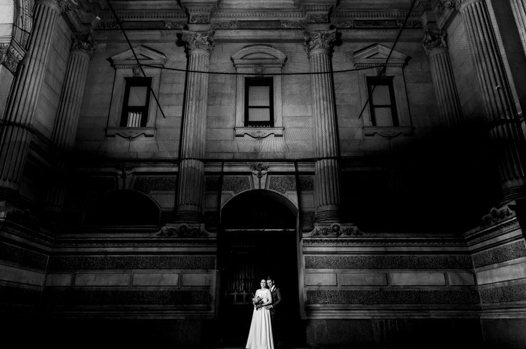 bride and groom inside Philly city hall courtyard