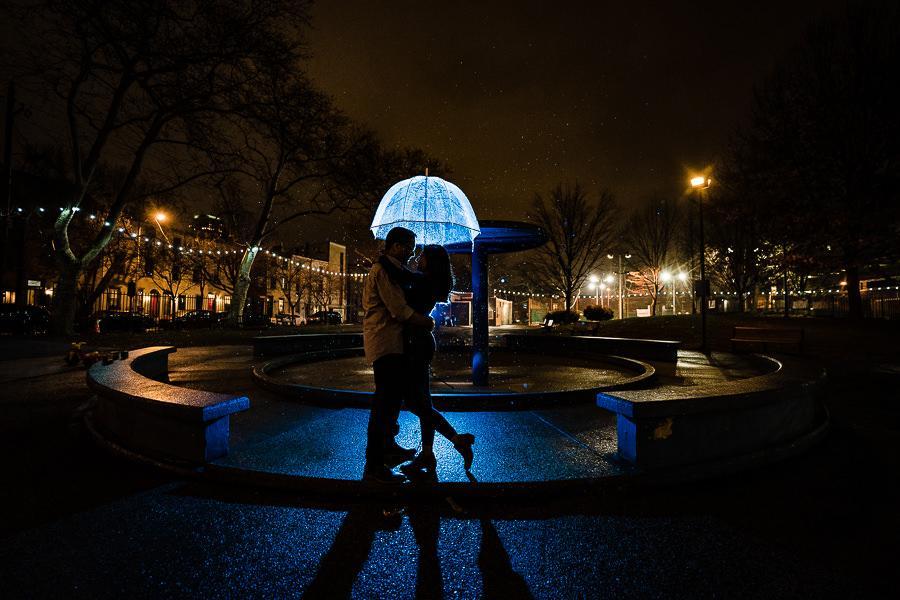 couple embrace at night ny fountain