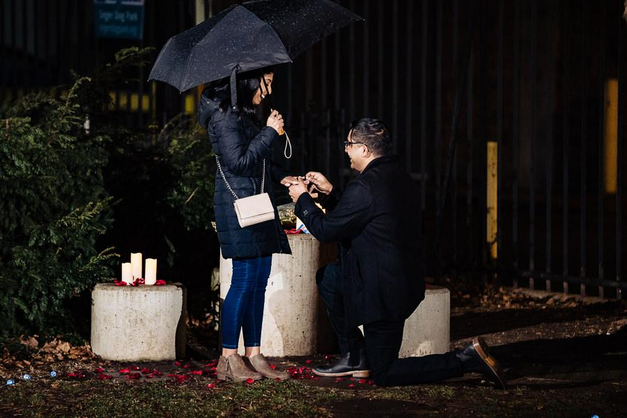 man on one knee proposes to woman