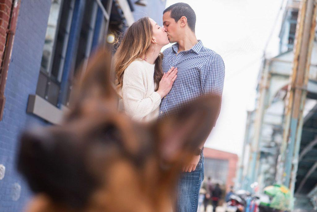 engaged couple and German Shepard