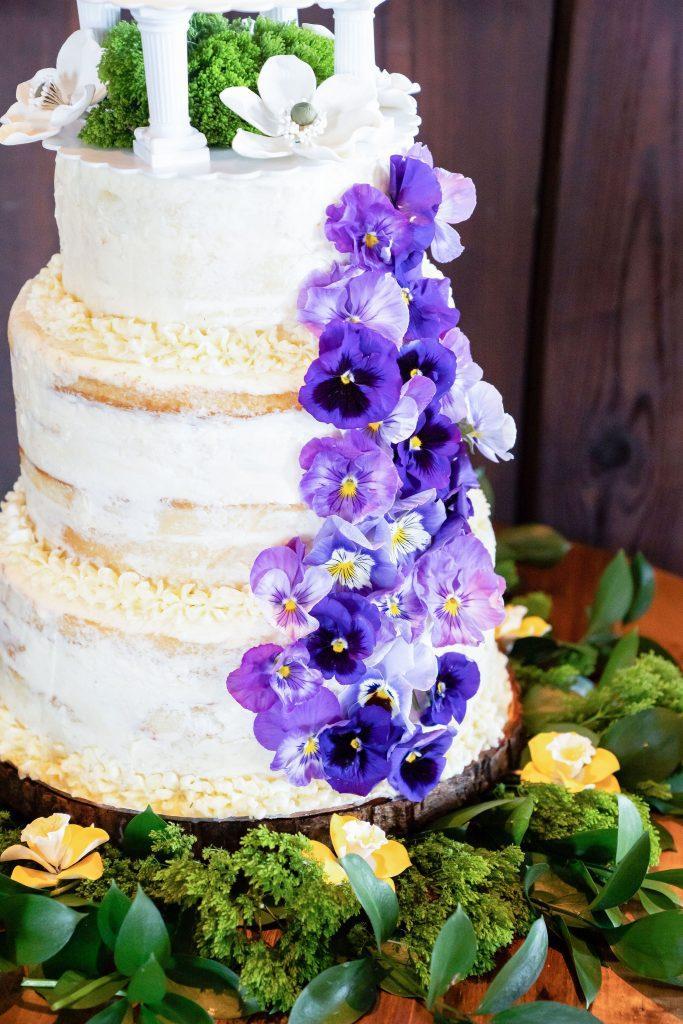 4 layer wedding cake with purple pansies