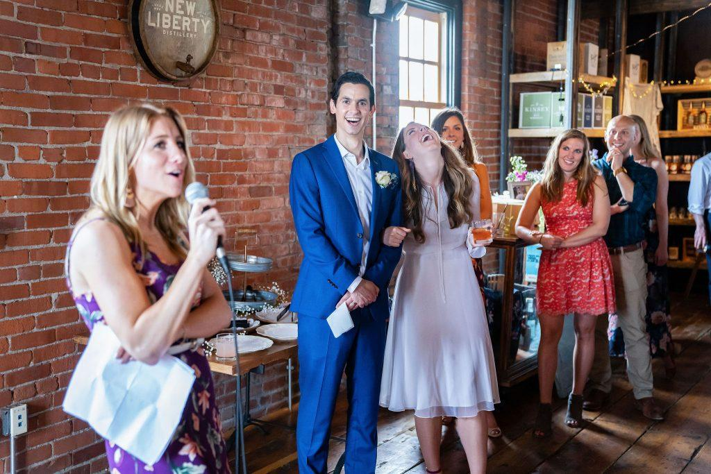 maid of honor makes toast at wedding