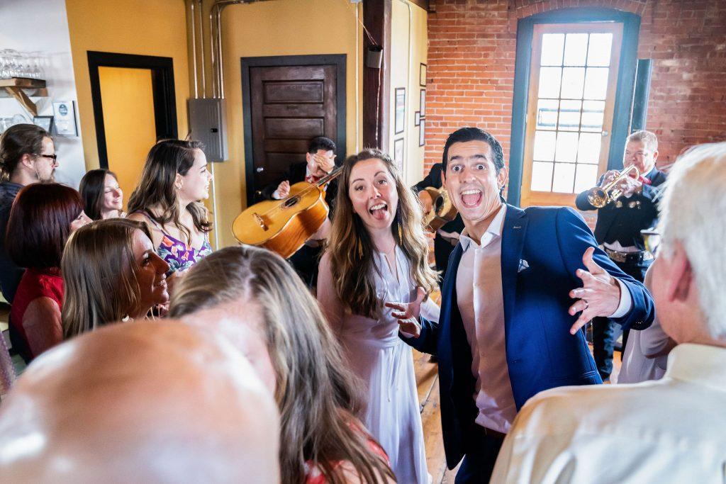 bride and groom mug for the camera at wedding reception