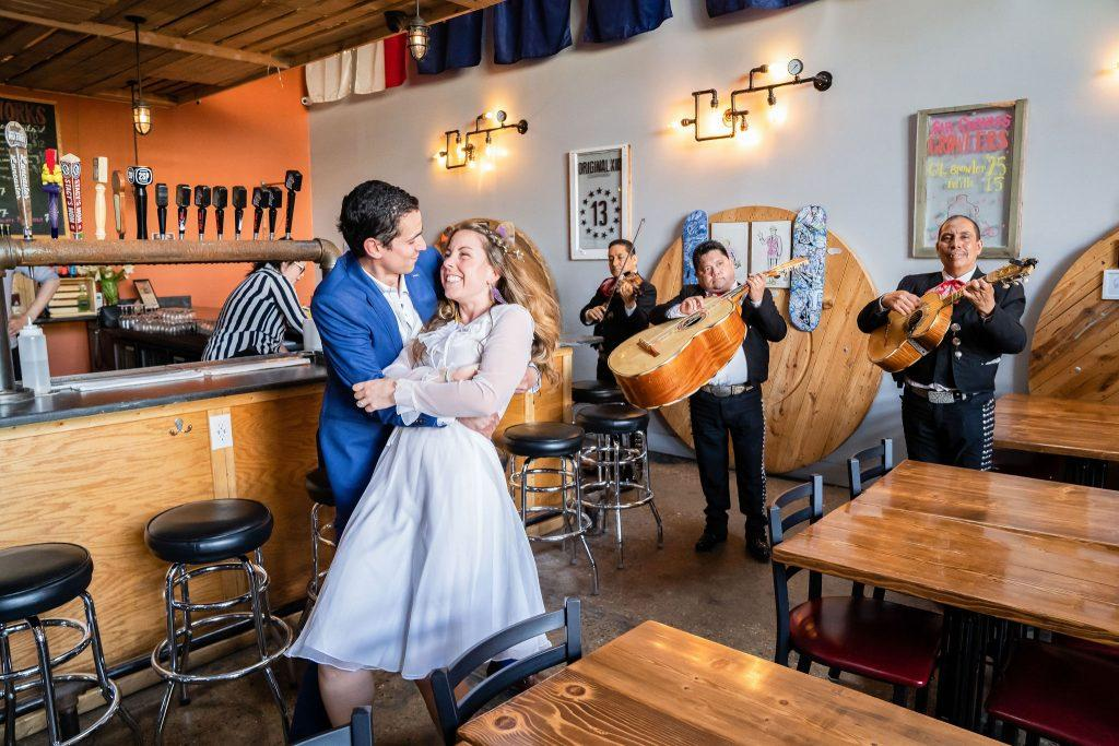 bride and groom dance at bar with band
