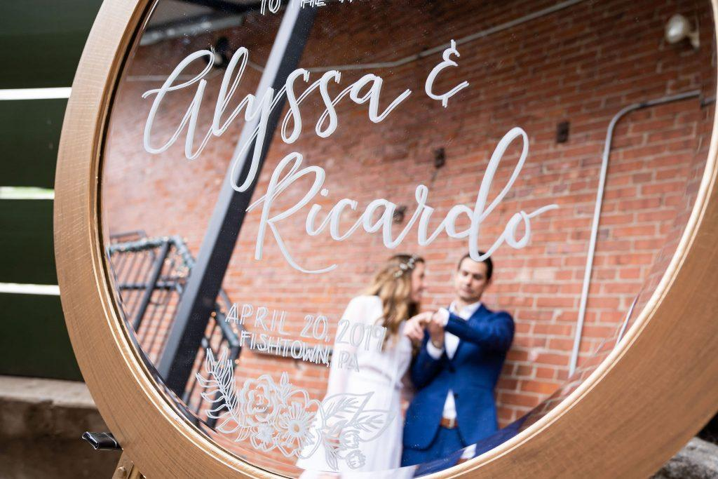 bride and groom's reflection in mirror
