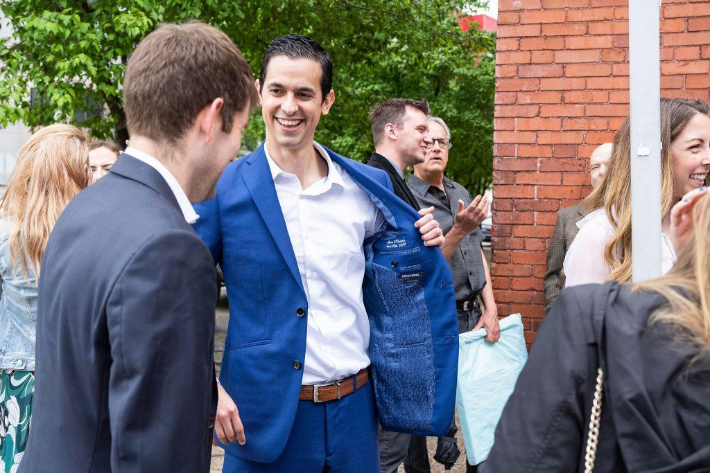 groom shows off lining of suit