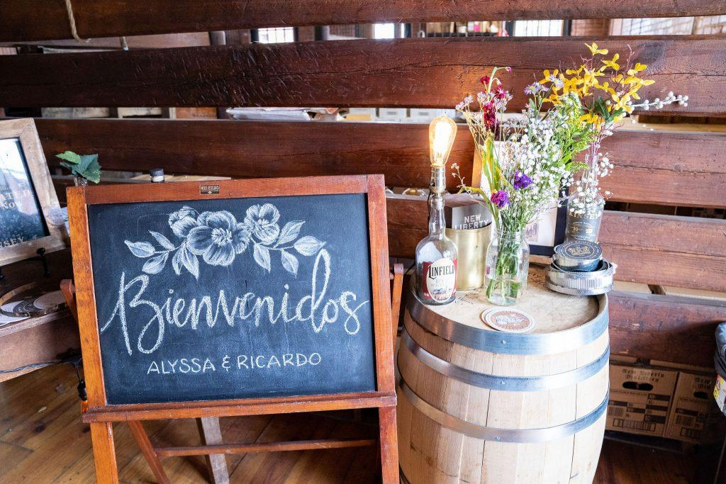 welcome sign and table at wedding reception