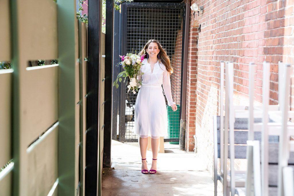 bride walks down aisle at wedding
