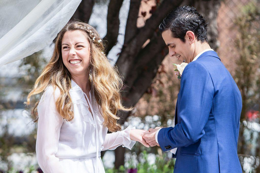 groom places ring on bride's left hand