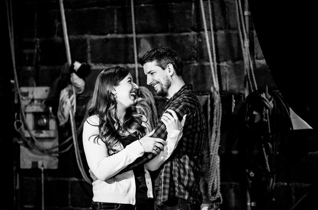 engaged couple hug backstage
