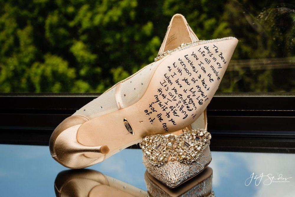 bridal shoes with message written on soles